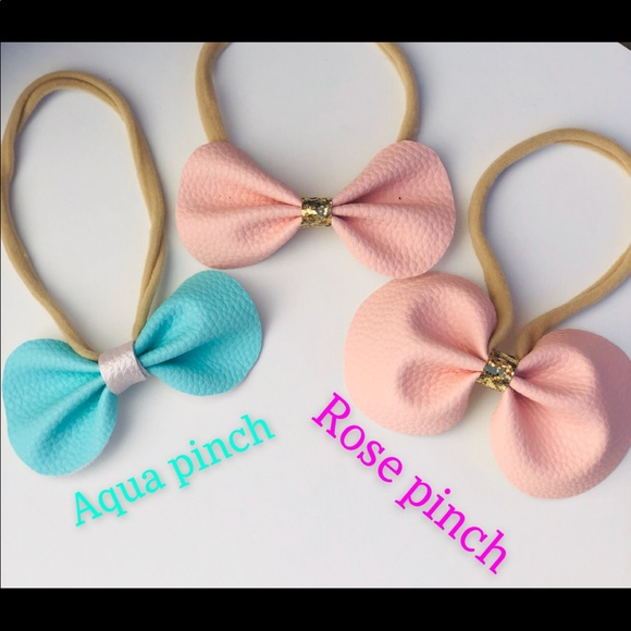 Other - Faux leather bows.